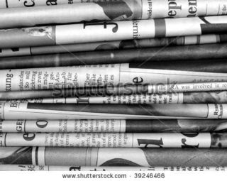 Stock-photo-stack-of-international-newspapers-in-black-and-white-39246466